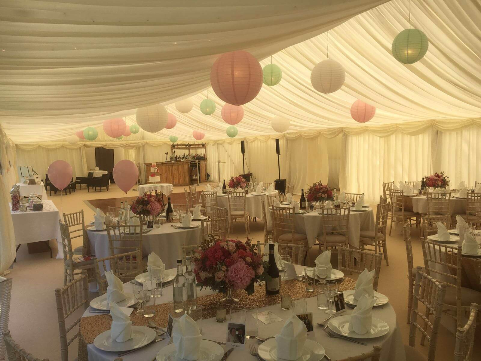 Wedding marquee, ivory pleasted linings and lanterns