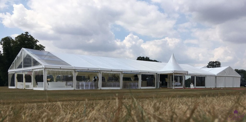 12m x 30m with clear roof section and additional catering and toilet marquee
