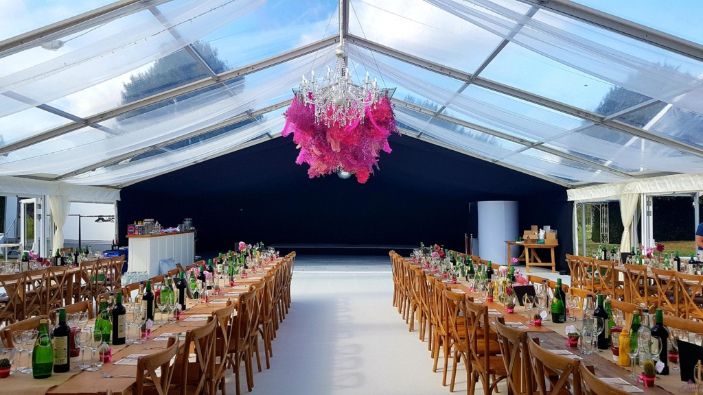 12m x 24m Marquee with clear roof dining section with rustic furniture.