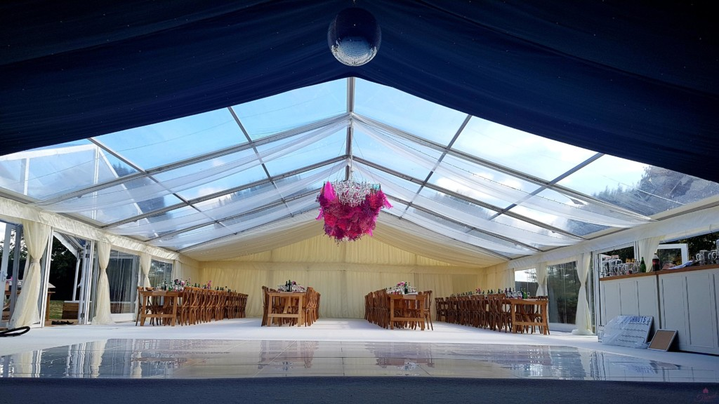 12m x 24m Marquee with dark, clear and opaque sections, polished white dance floor and rustic furniture