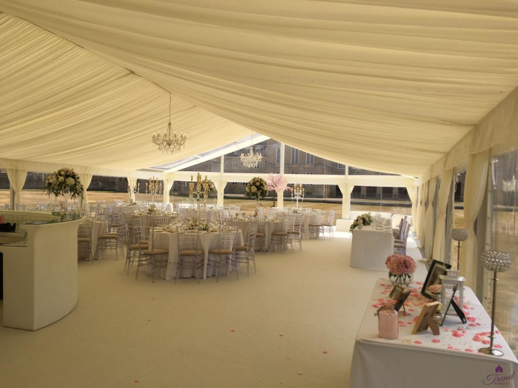 Classic ivory interior with ivory carpet and round tables for 120 guests. Clear end roof and gable with panoramic windows