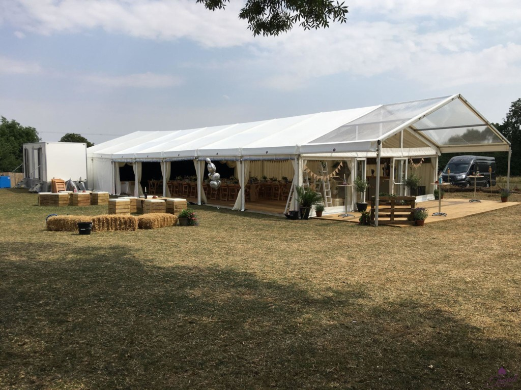 9m x 24m marquee with a decked clear roof canopy entrance and outdoor pallet furniture