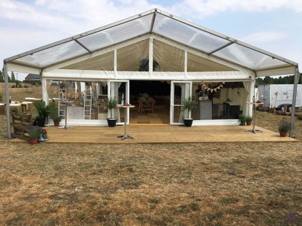 9m x 24m marquee with a decked clear roof canopy entrance
