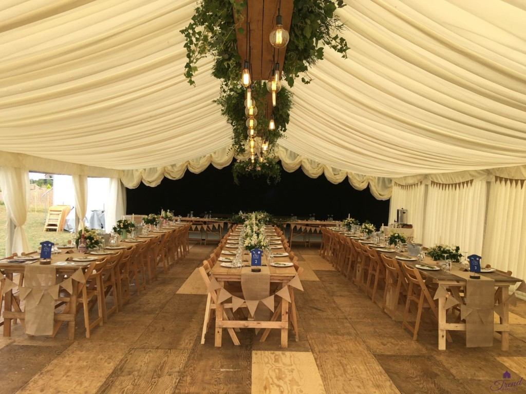 9m x 15m in ivory with rustic oak lighting, flooring and banquet seating for 80 guests. Reveal curtain hides a 9m x 6m starlit area with all white dance floor