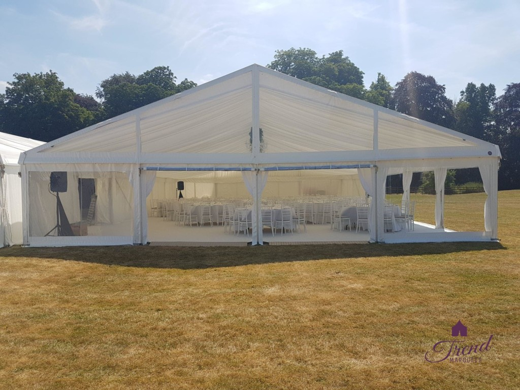 External view of 12m x18m Dining Marquee for 160 guests with clear end gable and panoramic windows