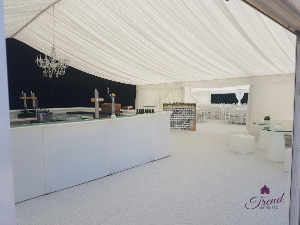 Side by side internal shot of two 12m structures, separating dining from the entertainment area. LED bar and crystal chandelier