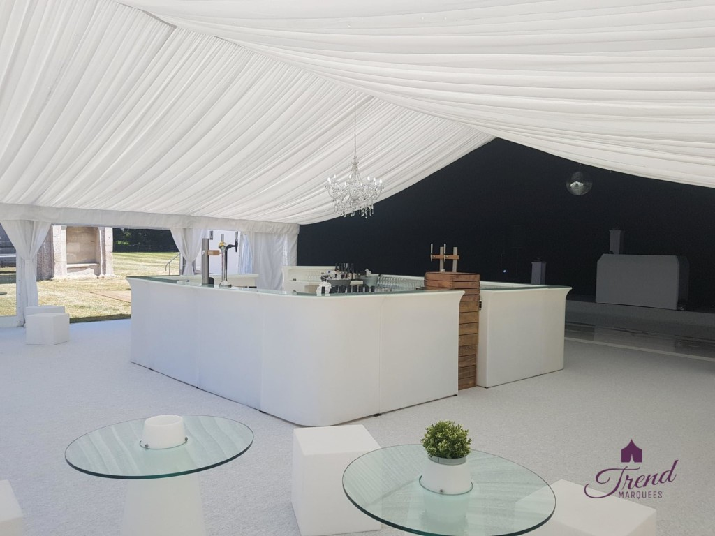 12m x 18m reception and entertainment marquee. Lined with half black starlight and half white, clear end gable and clear roof porch. Furnished with a square LED bar, LED furniture and an all white dance floor